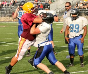 Braves lineman Justin Brady assets himself during pre-scrimmage drills against Smoky Mountain on Monday, Aug. 11.