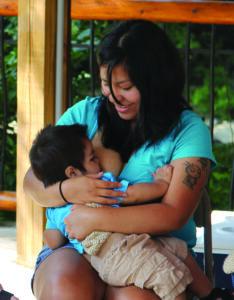 Stephanie Long breastfeeds her son, Xaldin Bird, during Friday's event.