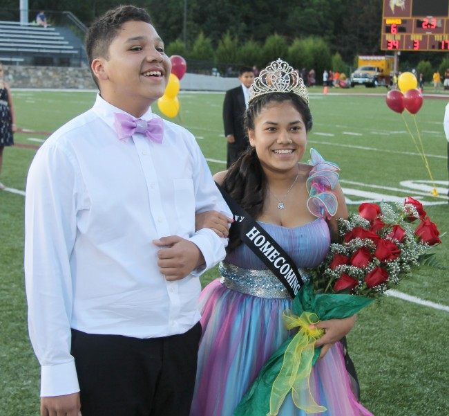 Jamie Lossiah (right), 8th grader at Cherokee Middle School, was named the 2014 CMS Homecoming Queen on Thursday, Sept. 25. She is shown escorted by Jaden Crowe. (SCOTT MCKIE B.P./photos)