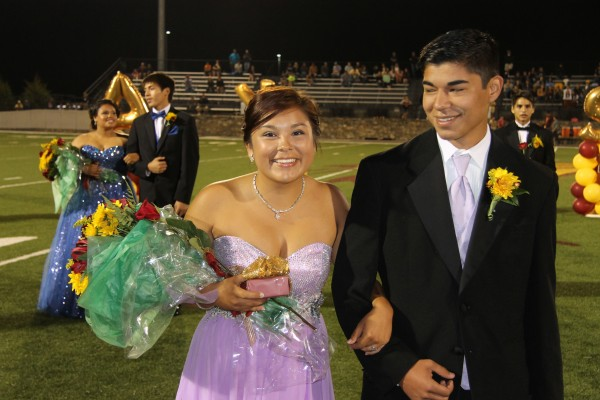 Bree Stamper (left), escorted by Cole Wildcatt, was named the CHS Maid of Honor during Homecoming Festivities on Friday night.