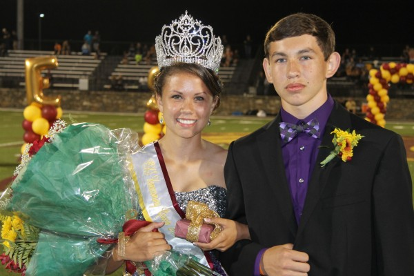 Kendall Toineeta (left), CHS senior, was named Homecoming Queen at Homecoming festivities at Ray Kinsland Stadium on Friday, Sept. 26.  She is shown escorted by her brother, Anthony Toineeta.  Kendall is wearing the newly-made Tahnee Arkansas Memorial Homecoming Crown made of Swarovski crystals in memory of the 2009 CHS Homecoming Queen who passed away recently.  The crown will be passed on to all future CHS Homecoming Queens.  (SCOTT MCKIE B.P./One Feather photos)