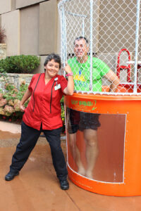 Harrah's Cherokee Casino Resort EVS Technician Gina Niccum (left) dunked Brooks Robinson (right), regional senior vice president and general manager, into a cold water tank at the Ducky Dunk Challenge on Sept. 20. The event was a part of the property's month-long efforts to raise money for the ALS Association.