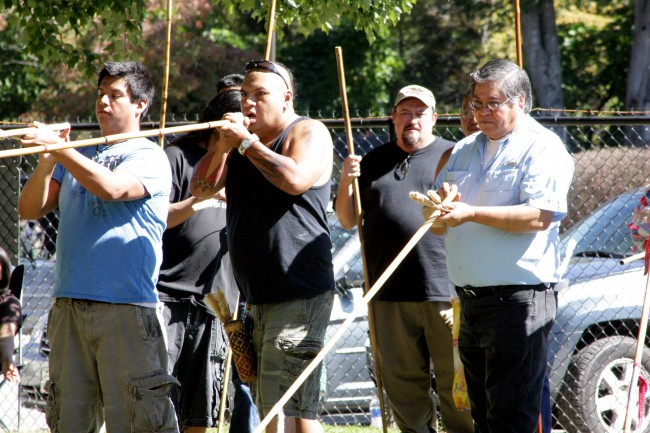 While his competition prepares their darts, Sonny Ledford (center) shoots during a past Fair's blowgun competition.  (DAWN ARNEACH/One Feather contributor)