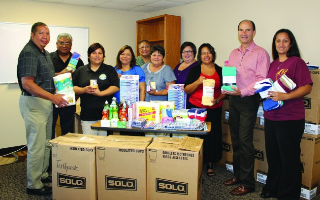 Harrah's Cherokee Casino Resort employees collected and donated more than 10,000 supplies for the Cherokee Public Health and Human Services division. Shown (left-right) are: Manager of Juvenile Services Clarence Jackson, Manager of Supplemental Health Insurance Calvin Hill, Emergency Housing Coordinator Tamara Jackson, Manager of Domestic Violence Program Iva Key, Manager of Community Health Vivian Solis, Manager of Family Services Barbara Jones, Manager of Home Health Melanie Ashe, Manager of Heart to Heart Brandi Cooper, Administrator of Tsali Care Center Davis Hunt, and Harrah's Cherokee Casino Administrator Michelle Sneed. (Harrah's Cherokee photo)