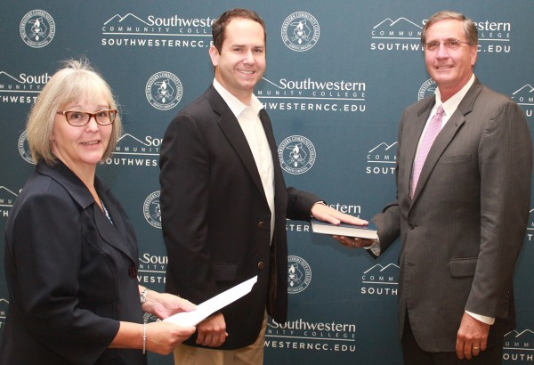 EBCI tribal member Jeremy Hyatt (center) was sworn in as a member of Southwestern Community College's Board of Trustees on Wednesday, Oct. 8, by Ann Melton (left), Jackson County clerk of superior court, and Dr. Don Tomas, president of SCC.  (SCC photo)