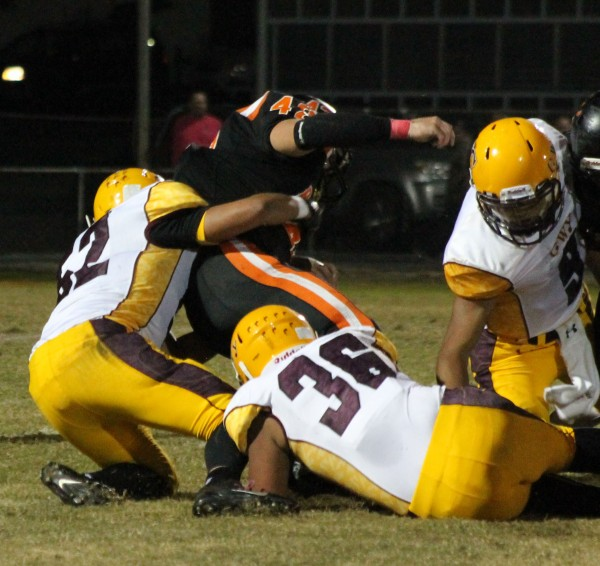 Logan Teesateskie (#52) and Kennan Panther (#36) combine to tackle Rosman's Tanner Green (#42).  Panther led the Braves with 23 tackles and Teesateskie had 21.