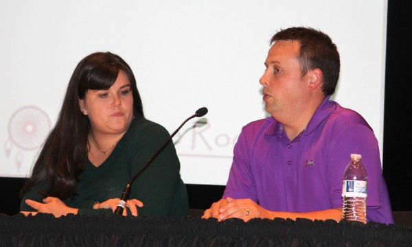 Jason Lambert (right), EBCI Commerce Division director, speaks during a Qualla 2020 Community Forum at the Chief Joyce Dugan Cultural Arts Center on Monday, Oct. 13 as Hope Huskey (left), of The Sequoyah Fund, looks on.  (SCOTT MCKIE B.P./One Feather)