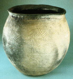 """This pot, by EBCI potter Eva Katolster, is in the collection of the Smithsonian National Museum of Natural History.  This stamped, open-fired pot was made by """"Iwi"""" in 1908, in the Qualla pottery style. (Photo courtesy of Museum of the Cherokee Indian)"""
