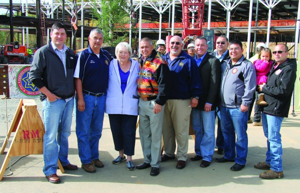 Tribal leaders gather at the topping-off ceremony on Friday including (left-right) Birdtown Rep. Albert Rose, Yellowhill Rep. B. Ensley, Painttown Rep. Tommye Saunooke, Principal Chief Michell Hicks, Big Cove Rep. Perry Shell, Cherokee County – Snowbird Rep. Brandon Jones, Birdtown Rep. Tunney Crowe, Cherokee County – Snowbird Rep. Adam Wachacha, and Wolfetown Rep. Bo Crowe.