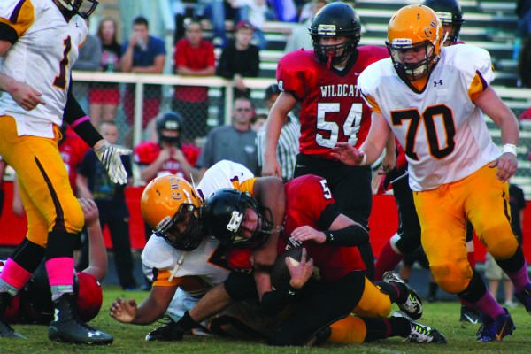 Zak Perez (#52) pummels an Andrews running back.  Cherokee's defense held strong all game long holding the Wildcats to only 16 points.