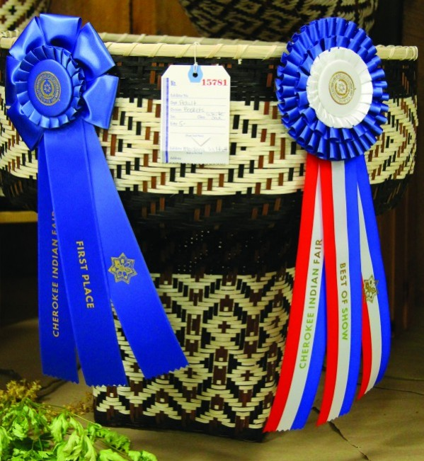 Maidena Wildcatt won a first place ribbon and a third place Best in Show ribbon for her White Oak Basket in this year's Qualla Arts and Crafts Mutual, Inc. contests at the Cherokee Indian Fair.  (SCOTT MCKIE B.P./One Feather)