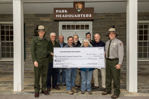 Shown (left-right) front row - Acting Superintendent Clay Jordan, Trout Unlimited President Mike Bryant, Sheila Bolinger, and Fisheries Biologist Matt Kulp; back row - Chuck James, Gary Verholek, Bill Bolinger, Davy Ezell, and retired Fisheries Biologist Steve Moore.  (NPS photo)