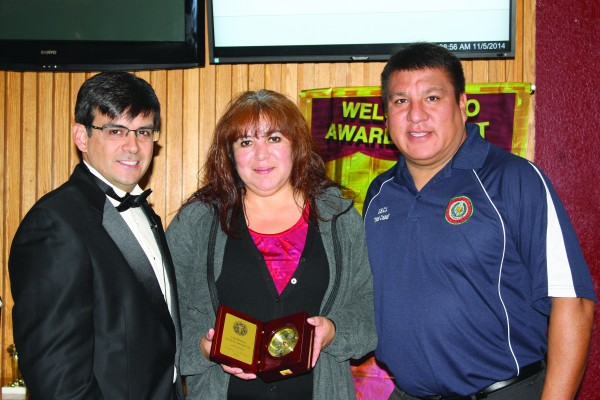 Christina Panther (center), manager of the Supply Department, has been named the Cherokee Indian Hospital Employee of the Year.  She is shown with Casey Cooper (left), Cherokee Indian Hospital Authority CEO, and Yellowhill Rep. David Wolfe who serves as the chairman of the EBCI Health Board.  (CIHA photo)