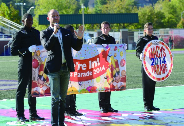 Wesley Whatley, creative director for Macy's Thanksgiving Day Parade, announces to members of the Western Carolina University Marching Band that they will be leading the annual holiday event through the streets of New York City. (Photo by Starfire Photo)