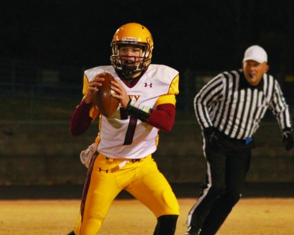 Tye Mintz (#7), Braves quarterback, drops back for a pass. He completed 10 of 24 passes for 188 yds, 2TD and 1 INT.