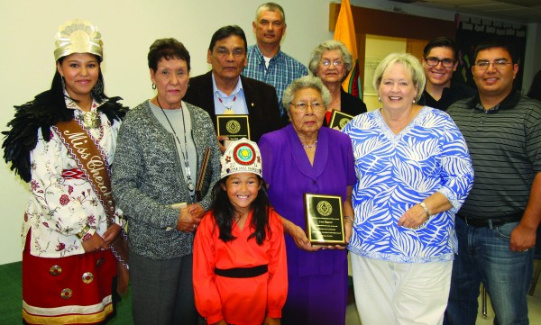 Miss Cherokee Taylor Wilnoty (left) poses with the recipients of the Distinguished Citizen Award at Ned Long Day on Wednesday, Oct. 29 at the Cherokee Youth Center.  (SCOTT MCKIE B.P./One Feather)