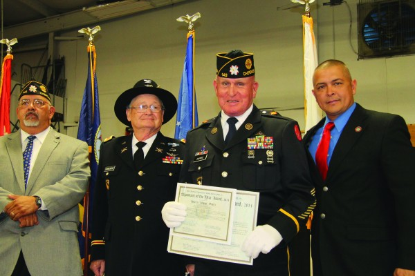 Warren Dupree (2nd from right) was given the Legionnaire of the Year Award at the Veteran's Day Ceremony hosted by the Steve Youngdeer American Legion Post 143 at the Cherokee Indian Fairgrounds on Tuesday, Nov. 11. Shown (left-right) are Big Cove Rep. Perry Shell, a U.S. Army veteran; Col. Bob Blankenship, former Tribal Council Chairman and a Vietnam Veteran; Dupree; and Principal Chief Michell Hicks. (SCOTT MCKIE B.P./One Feather photos)