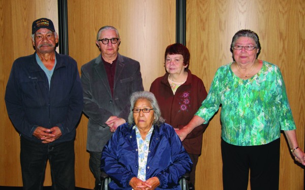 Cherokee High School held its Honor the Elders program on Friday, Dec. 5 at the Chief Joyce Dugan Cultural Arts Center and five people were honored including: standing (left-right) - Bob Reed, Richard Saunooke, Linda Saunooke and Phyllis Sequoyah; and sitting - Rosie Hornbuckle. (SCOTT MCKIE B.P./One Feather)