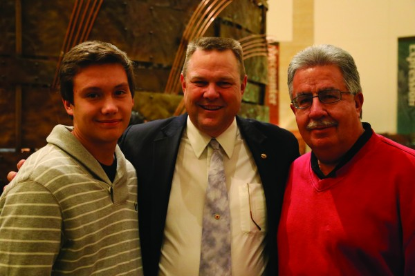 Steven Straughan (left), tribal youth ambassador, and Vice Chief Larry Blythe (right) are shown with Sen. Jon Tester (D-Mont.) who is the chairman of the Senate Committee on Indian Affairs.