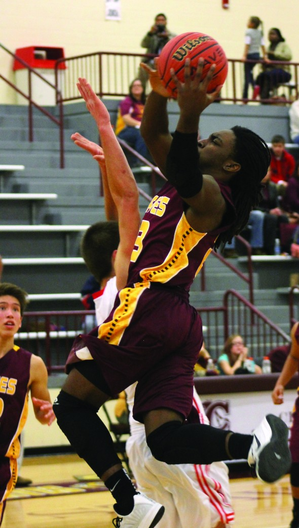 J.J. Benjamin (#23), Braves forward, goes for a layup in the second half.