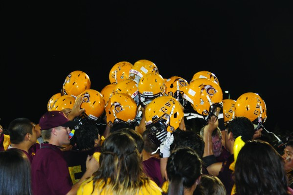 Helmets up!  The Braves celebrate with their fans following their victory over Choctaw Central in the annual Battle of the Nations game in September.  (SCOTTMCKIEB.P./One Feather)