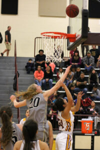 Tiffani Riggins (#24), Lady Braves senior guard, shots around Hayesville's Amanda Thompson in the first half of Friday's home game.  Riggins had eight points on the night.