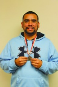 Will Poolaw is shown with a medal he won at the Special Olympics last fall.  (SCOTT MCKIE B.P./One Feather)