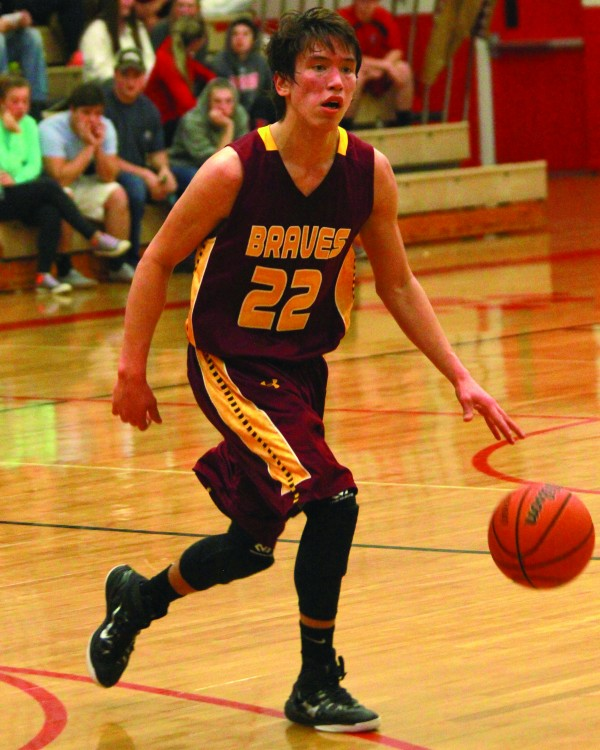 Dustin Johnson, Braves senior point guard, brings the ball up the court at Franklin on Wednesday, Jan. 21.  Johnson led the Braves with 34 points as Cherokee improved to 17-0 on the season.  (AMBLE SMOKER/One Feather)