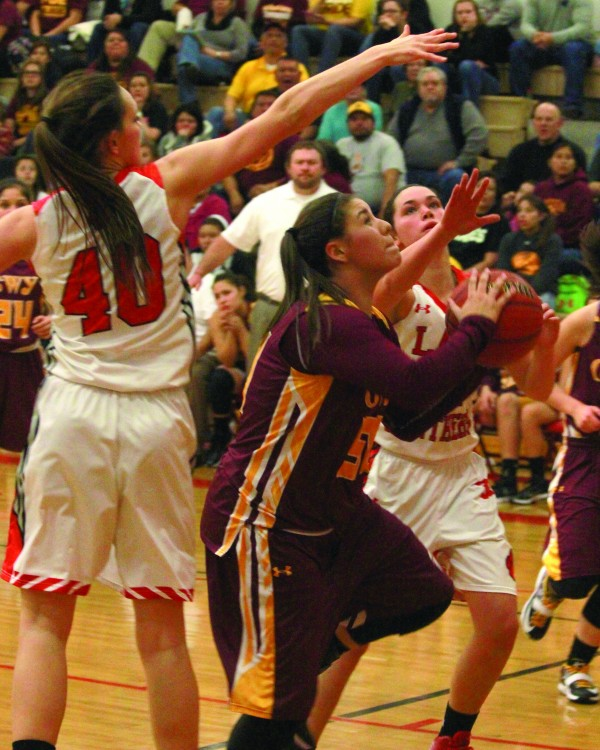Timiyah Brown (#50), Lady Braves freshman forward, ducks under Franklin's Kirsey Apel (#40) during a game an away game on Wednesday, Jan. 21.  Brown scored 13 points as the Lady Braves improved to 16-0 on the season with a 62-55 win.    (AMBLE SMOKER/One Feather)