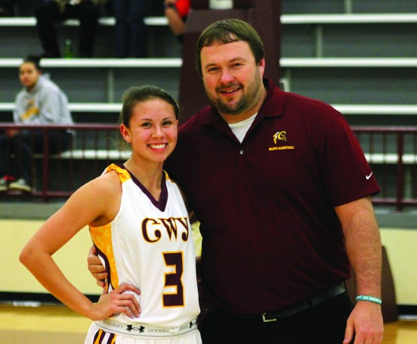 Toineeta poses with Lady Braves head coach Chris Mintz moments after she broke the all-time scoring record.  The game was stopped momentarily to recognize the accomplishment.