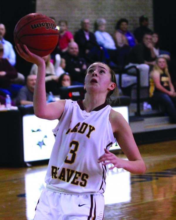 Tori Teesateskie, Cherokee Middle School Lady Braves, scores on a lay-up during a semi-final game against the Murphy Middle School Lady Bulldogs on Tuesday, Jan. 20.  (AMBLE SMOKER/One Feather)