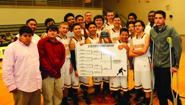The Cherokee Middle School Braves pose with the brackets of the Smoky Mountain Conference tournament they won on Wednesday, Jan. 21.  They went 15-0 on the season and also won the regular season conference title.   (AMBLE SMOKER/One Feather)