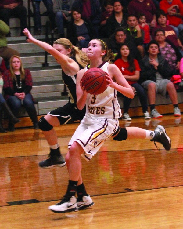 Tori Teesateskie (#3), Cherokee Middle School Lady Braves, goes for a shot during the finals of the Smoky Mountain Conference tournament at Robbinsville on Thursday, Jan. 22.   (AMBLE SMOKER/One Feather)