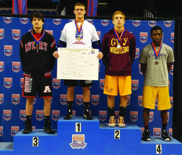 Cherokee's Jaron Bradley (2nd from right), took second place in the 145lb division at the 1A state wrestling tournament on Saturday, Feb. 21.  Shown (left-right) are Preston Childress (Avery), third place; Dalton Beaver (Mitchell), first place; Bradley; and Joseph Waters (Rosewood), fourth place.   (Photo courtesy of Anthony Swearengin)