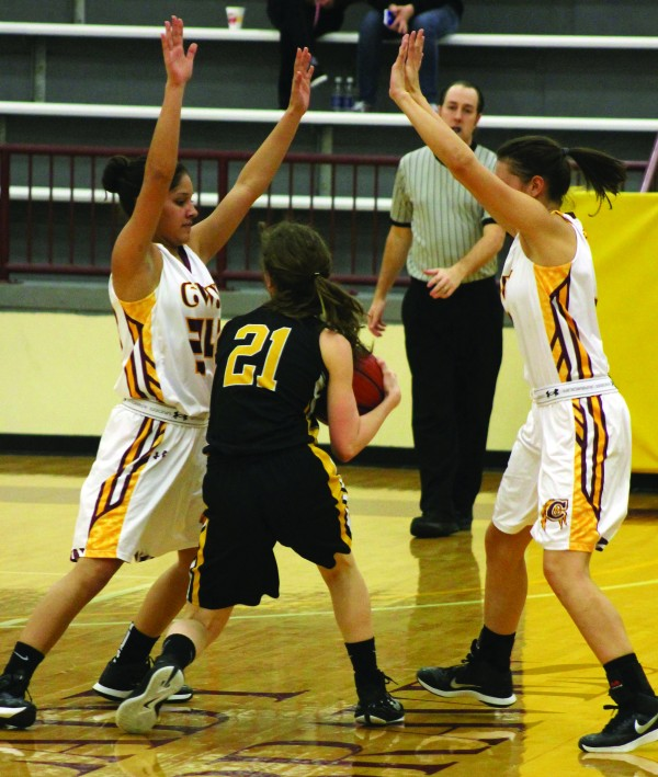 The Lady Braves played stifling defense against the Murphy Lady Bulldogs in a home game on Tuesday, Feb. 3.  Here, Cherokee's Tiffani Riggins (#24) and Kendall Toineeta (#3) give Murphy's Jenna Bello (#21) little options.   (SCOTT MCKIE B.P./One Feather)