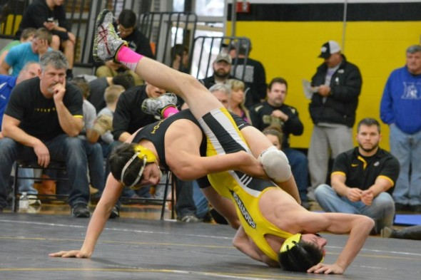 Cherokee's Anthony Toineeta (in black) prepares to pin Stephen O'Bryon, Murphy, in the finals of the 138lb division at the Smoky Mountain Conference wrestling tournament on Saturday, Jan. 31 at Murphy High School.  (DENISE WALKINGSTICK/One Feather contributor photos)