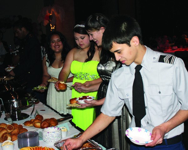 JROTC Cadets enjoy the food table at the CHS Military Ball on Thursday, March 17.   (AMBLE SMOKER/One Feather photos)