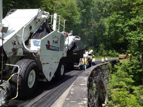 Crews work on paving at Cole Creek.