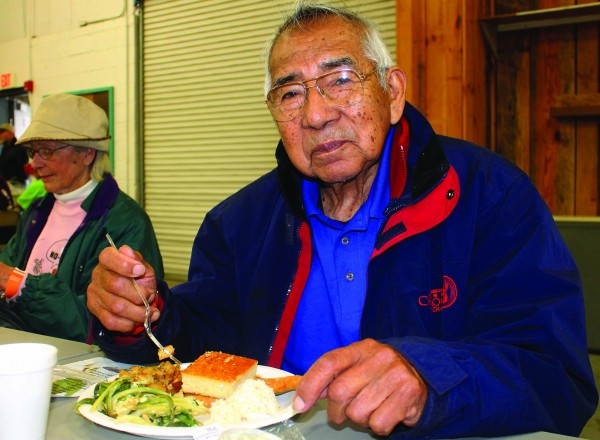 EBCI Beloved Man Jerry Wolfe enjoys a rainbow trout and ramps dinner at last year's event.   (SCOTT MCKIE B.P./One Feather)