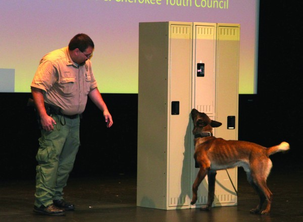 Cherokee Indian Police Dept. Sgt. John Taylor and his partner, Ranger, give a drug search demonstration during Monday's presentation.