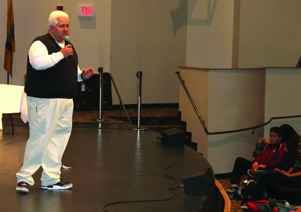 """Shawn Crowe, emcee for Monday's """"No One Plans To Be An Addict"""" event at Cherokee Central Schools, talks to the students about the perils of drug and alcohol addiction. (SCOTT MCKIE B.P./One Feather photos)"""