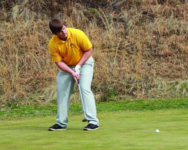 Christian Ensley putts during a four-team match at The Smoky Mountain Country Club on Thursday, March 12.  He led the Braves with a score of 43.  (AMBLE SMOKER/One Feather)