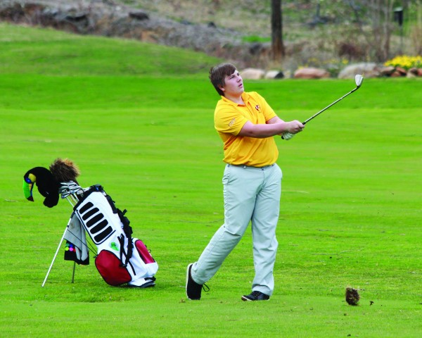 Cherokee's Christian Ensley follows through on a shot during a four-school match at the Maggie Valley Country Club on Tuesday, March 17.  Ensley led all golfers on the course with a career-low 40.  (AMBLE SMOKER/One Feather)