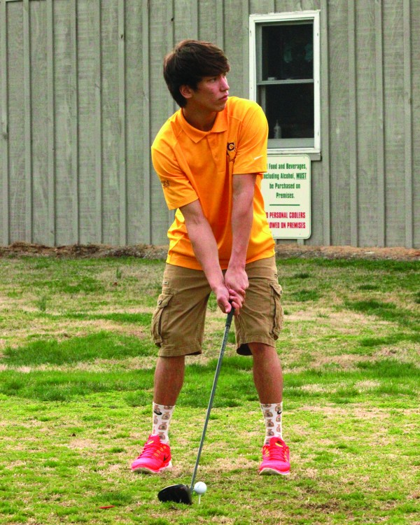 Cherokee senior Dustin Johnson prepares for a tee shot in a five-team match at The Golf Club at Mill Creek in Franklin on Tuesday, March 24.  He finished third overall with a career best 46.  (AMBLE SMOKER/One Feather)
