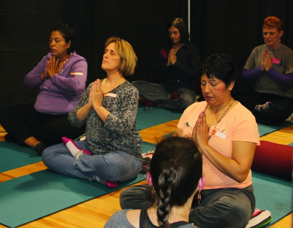 Participants in the 1st Annual Healing and Wellness Retreat, held on March 20-21 at the Birdtown Recreation Center, practice yoga techniques.  (AMBLE SMOKER/One Feather photos)