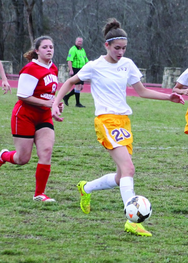 Cherokee's Alyssa Land runs past the Haywood Christian defense en route to a goal in the second half of a home match on Thursday, March 12.   (SCOTT MCKIE B.P./One Feather)