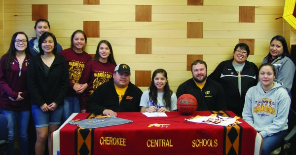 Riggen (center) is shown with her teammates and coaches.