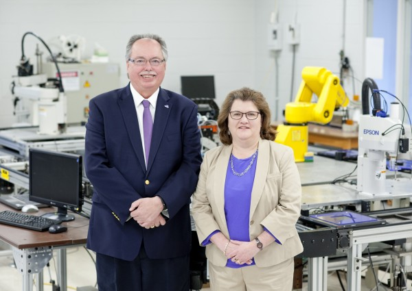 Jeffery Ray (left), dean of the Kimmel School of Construction Management and Technology at Western Carolina University, and wife Tina Hopkins Ray, who recently established a scholarship fund to provide financial support to students who have participated in FIRST Robotics competitions, visit a robotics lab on the WCU campus.  (WCU photo)