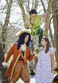 """Peter Pan (played by Michael Gallagher) looks down from the trees as Captain Hook (Phillip Culton) makes a point to Wendy (Claire Vanderlinden) in a scene from Western Carolina University's upcoming production of """"Peter Pan: The Boy Who Would Not Grow Up."""" (WCU photo)"""