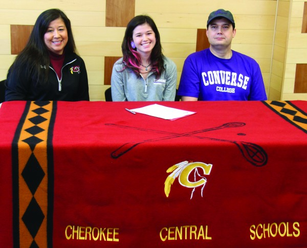 Reagan Barnard (center), Lady Braves senior forward, signs a letter of intent on Monday, April 20 to play college basketball at Converse College as her parents Roberta Barnard (left) and Doug Barnard look on.  (SCOTT MCKIE B.P./One Feather photos)